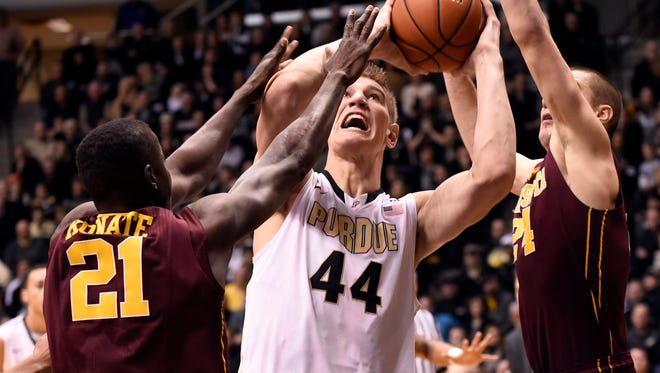 Dec 31, 2014; West Lafayette, IN, USA; Purdue Boilermakers center Isaac Haas (44) fights to shoot as Minnesota Golden Gophers center Bakary Konate (21) and Minnesota Golden Gophers forward Joey King (24) defend in the first half at Mackey Arena. Mandatory Credit: Sandra Dukes-USA TODAY Sports