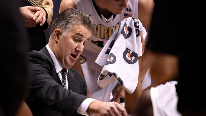 Purdue Boilermaker head coach Matt Painter talks to his team in the 2nd half against the Minnesota Golden Gophers at Mackey Arena. Purdue defeated Minnesota 72-68.