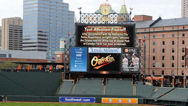 An announcement on the scoreboard notifies fans that the game between the Baltimore Orioles and the Chicago White Sox has been postponed at Oriole Park at Camden Yards on Monday, April 27, 2015, in Baltimore, Maryland.