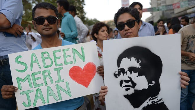 Pakistani civil society activists hold images of assassinated rights campaigner Sabeen Mahmud during a protest in Karachi on April 30, 2015.