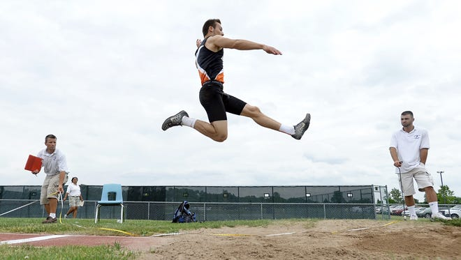 Churchville-Chili's Alex Siracusa won the long jump (Class A) with a distance of 21-00.75 feet during the Section V Class AA/A Track & Field Championships held at Victor High School on Saturday, May 30, 2015.