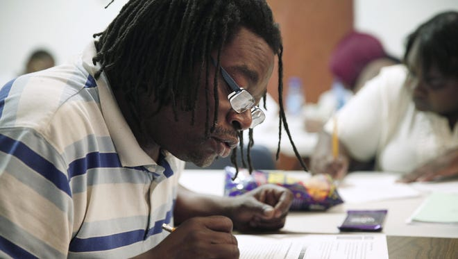 James Ross works on a science problem in his GED class at the Inner Faith Gospel Tabernacle on York Street in the city. Ross is in a class organized by the PEACE (Partners in Excellence: Achieving Careers and Education) Initiative, founded by United Christian Leadership Ministry of Western New York with Monroe 2-Orleans BOCES.