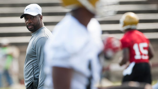 Alabama State University head football coach Brian Jenkins directs his team at its first practice on Wednesday August 5, 2015 on the ASU campus in Montgomery, Ala.