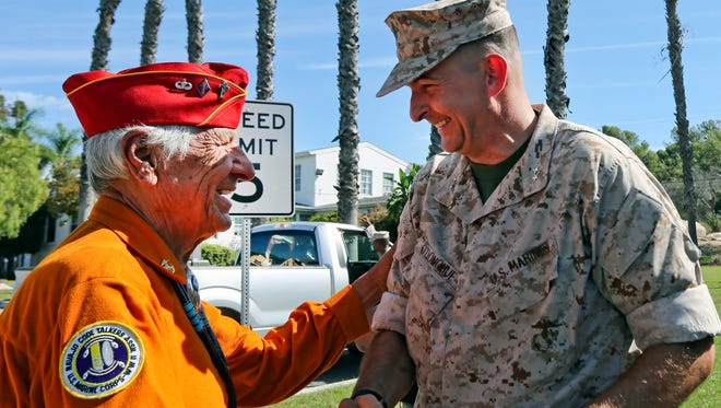 United States Marine Maj. Gen. Daniel Donohue, right, says goodbye to former United States Marine and Navajo Code Talker Roy Hawthorne following a ceremony in September honoring the Navajo Code Talkers contributions to the American effort in World War II  at Camp Pendleton, Calif.  Hawthorne served as a Navajo code talker with the U.S. Marine Corps from 1943 to 1945, hopping from island to island across the South Pacific as U.S. troops fought their way toward Japan.