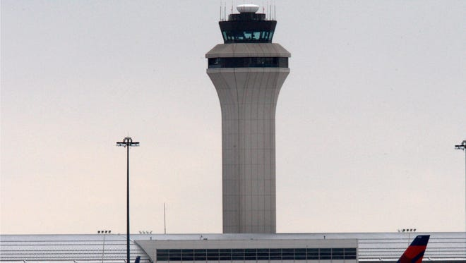 This file photo from Dec. 26, 2009, shows the air traffic control tower at the Detroit Metro Airport.