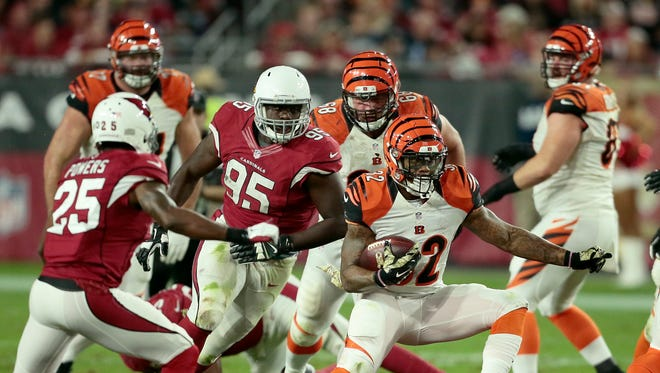 Bengals running back Jeremy Hill carries the ball in the second quarter.