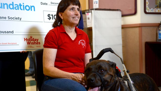 Linda Hibbard and her service dog Brindy pose for a photo on Tuesday after attending a ceremony honoring a $100,000 donated by the Petco Foundation to the Nevada Humane Society.