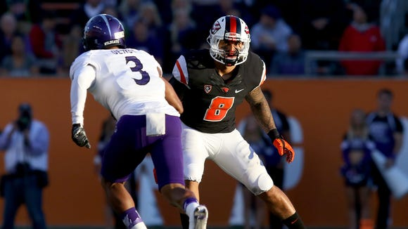 Oregon State linebacker Rommel Mageo (8) drops back into coverage in the 2015 season opener against Weber State at Reser Stadium.