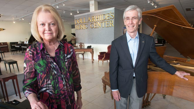 Bill Dollarhide, right, and his wife, Margaret are planning to close their downtown music store at the end of May and begin retirement. Dollarhide's Music Center has been a fixture on since the piano retailer open Palafox Street in 1988.