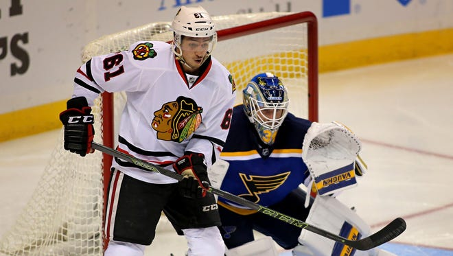 The Chicago Blackhawks' Garret Ross (61) tries to redirect a shot past St. Louis Blues goalie Jake Allen on Oct. 1, 2015.