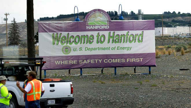 """This July 9, 2014 file photo shows a sign that says """"Where Safety Comes First"""", which welcomes visitors to the Hanford Nuclear Reservation near Richland, Wash."""