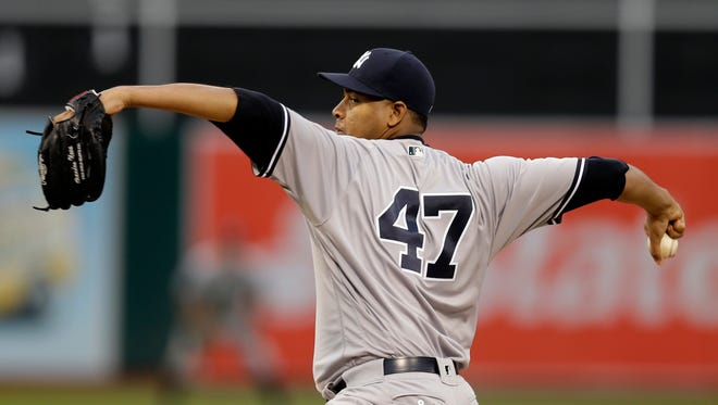 New York Yankees pitcher Ivan Nova works against the Oakland Athletics during the first inning of a baseball game Thursday, May 19, 2016, in Oakland, Calif.
