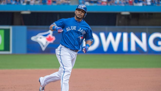 Toronto Blue Jays DH Edwin Encarnacion runs the bases after hitting a three run home run against the Cleveland Indians.