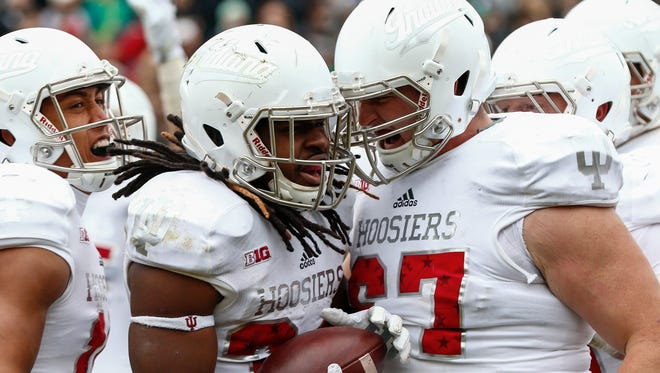 Dan Feeney (right) celebrates with Devine Redding after the Hoosiers running back scored against Purdue in 2015.