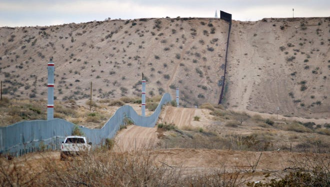 In this Jan. 4, 2016, file photo, a U.S. Border Patrol agent drives near the U.S.-Mexico border fence in Sunland Park, N.M.