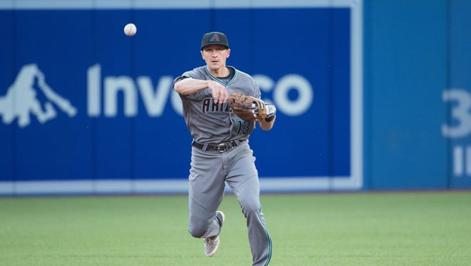 Jun 21, 2016;: Arizona Diamondbacks shortstop Nick Ahmed (13) throws a ball to first base for an out during the fifth inning in a game against the Toronto Blue Jays at Rogers Centre. The Arizona Diamondbacks won 4-2.