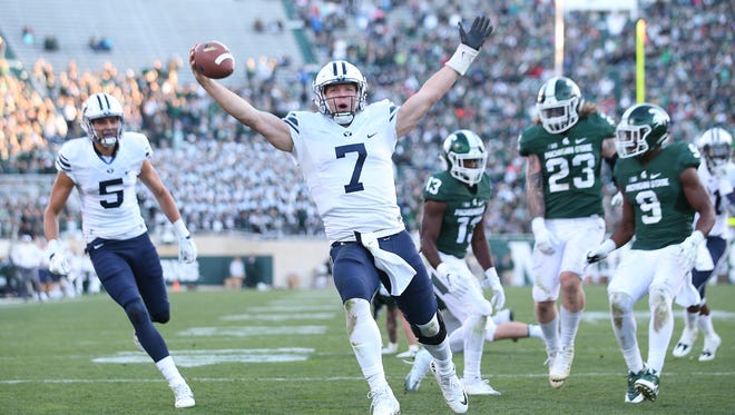 Taysom Hill of Brigham Young runs for a fourth-quarter touchdown against Michigan State at Spartan Stadium on Oct. 8, 2016, in East Lansing.