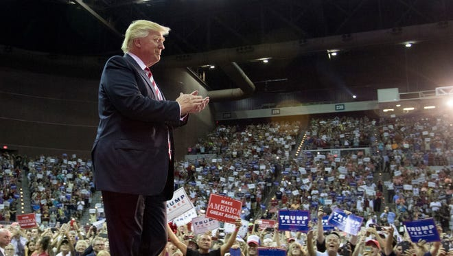 Donald Trump walks onto the stage Sept. 9, 2016, during a rally at the Pensacola Bay Center.