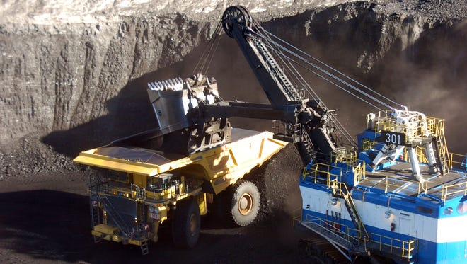 In this Nov. 15, 2016, photo, a mechanized shovel loads coal from an 80-feet thick seam into a haul truck at Cloud Peak Energy's Spring Creek mine near Decker, Mont. Coal from the mine is shipped to power plants for generating electricity. The Interior Department has put on hold changes to how it values coal extracted from public lands after mining companies sued in federal court to challenge the rules. Interior officials say in a Federal Register announcement due to be published Monday, Feb. 27, 2017, that current rules will remain in place pending a court decision. The changes, crafted under the administration of President Barack Obama, were aimed at ensuring companies don't shortchange taxpayers on coal sales to Asia and other markets.