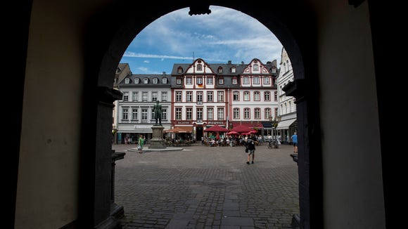 Jesuit Square seen through the arched tunnel of Koblenz city hall.