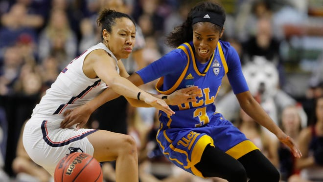 UCLA Bruins guard Jordin Canada (3) works for the ball against Connecticut Huskies guard Saniya Chong (12) during the second half in the semifinals of the Bridgeport Regional of the women's 2017 NCAA Tournament at Webster Bank Arena on Saturday, March 25th, 2017.