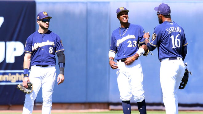Brewers outfielders Ryan Braun, Keon Broxton and Domingo Santiago wait for a pitching change during the third inning against the Athletics on Sunday in Phoenix.