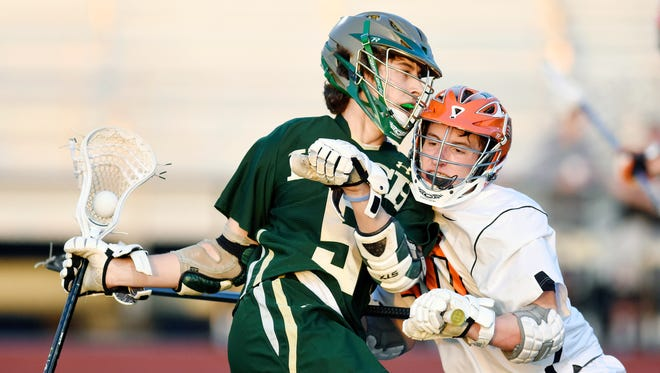 York Catholic's Eli Doyle, left, was a standout for the Irish on Thursday in a 15-14 win over Dallastown.
