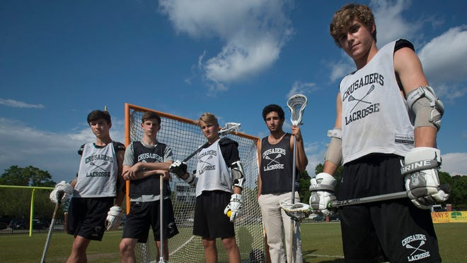 Catholic High School Lacrosse starters, Nin Mann, left, Jack Bartkowski, left, center, Bryant Mixon, center, Travis Wicker, right center, and Will Butler, spend Wednesday April 12, 2017, preparing for Thursday night's playoff game at Tallahassee Maclay.