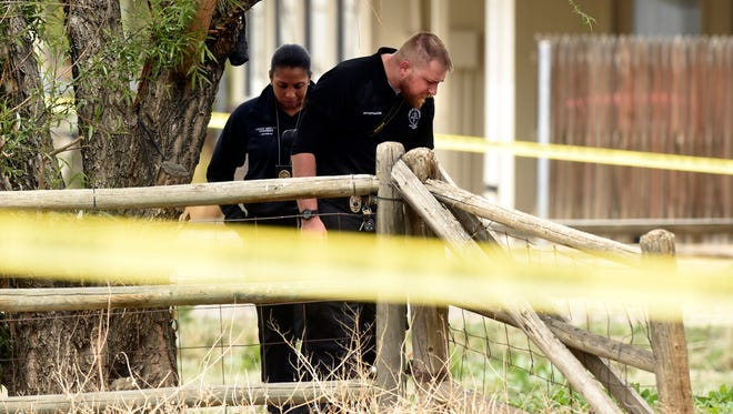 """Authorities investigate a child's death on Thursday, April 27, 2017, in Broomfield, Colo. Police have arrested a man after a 4-year-old boy was found dead in a Colorado home. Broomfield police spokeswoman Joleen Reefe says 25-year-old Emanuel Doll was arrested Thursday on a homicide charge after the boy was found dead with a """"massive amount of trauma.""""  (Jeremy Papasso/Daily Camera via AP)"""