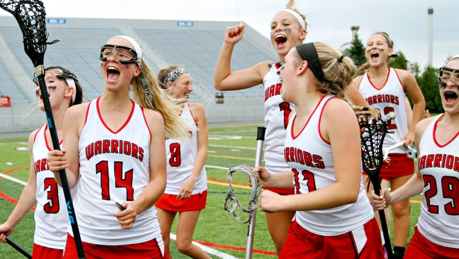 Susquehannock's Gena Speights (14) and her teammates celebrate a 13-12 victory over Kennard-Dale in the District 3 Class 2-A girls' lacrosse championship game at Hersheypark Stadium in Hershey, Wednesday, May 24, 2017. Dawn J. Sagert photo