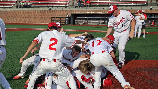 Lakota West players mob each other after defeating Saint Xavier.