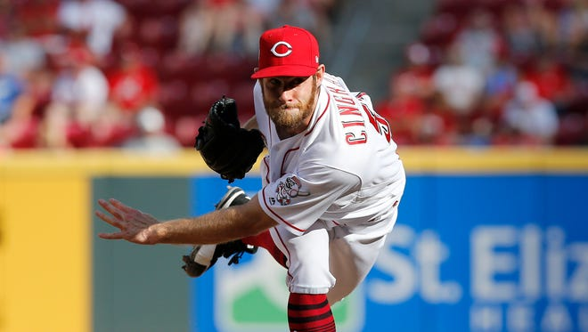 Cincinnati Reds relief pitcher Tony Cingrani (52) follows through on a pitch in the top of the sixth inning against the Los Angeles Dodgers at Great American Ball Park on Saturday, June 17, 2017.