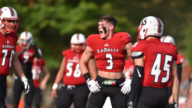 Shane McNally gets the Lancers pumped up before their game against Colerain during the Skyline Chili Crosstown Showdown, Friday, August 25th at LaSalle High School