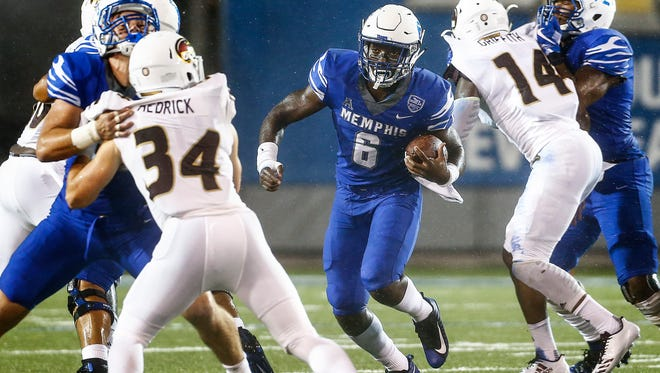 University of Memphis running back Patrick Taylor, Jr. (middle) scrambles past the University of Louisiana-Monroe defense for a touchdown run during first quarter action at the Liberty Bowl Memorial Stadium.