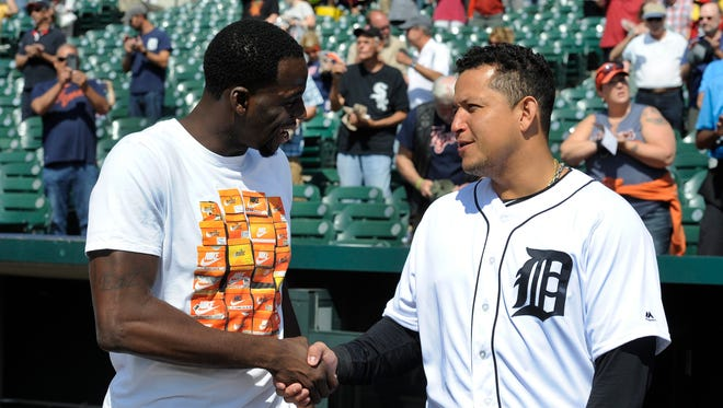Draymond Green of the Golden State Warriors, left, shakes hands with Tigers first baseman Miguel Cabrera prior to a baseball game against the White Sox, Thursday, Sept. 14, 2017 in Detroit.