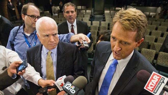 U.S. Sens. John McCain (left) and Jeff Flake answer questions in Mesa in 2013.