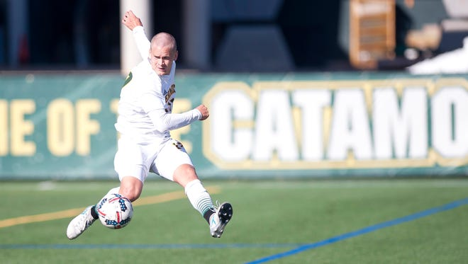 Vermont's Ivar Orn Arnason leaps to control a ball against Binghamton during Saturday's men's soccer game at Virtue Field.