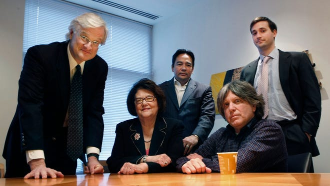 Plaintiff Elouise Cobell, center, sits with her legal team on Dec. 8, 2009, in the law offices of Kilpatrick & Stockton in Washington after filing a class-action lawsuit against two federal agencies over the alleged mismanagement of Native American land royalties.