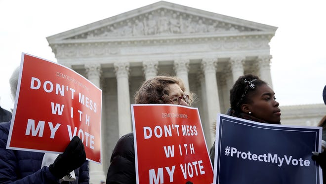 Demonstrators rallied outside the Supreme Court Wednesday as the justices heard a case from Ohio about purging voters.