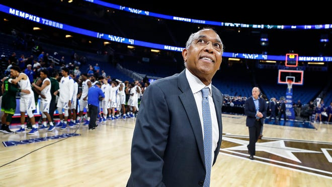 Memphis head coach Tubby Smith smiles while walking off the court after beat USF 79-77 USF at the AAC tournament game in Orlando, Fl., Thursday, March 8, 2018.