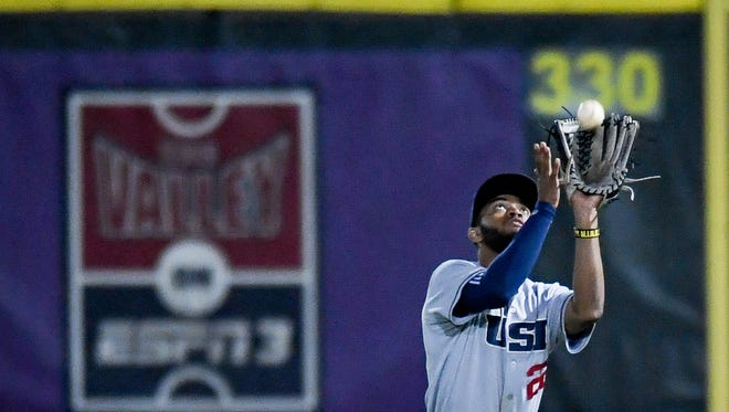 Southern Indiana's Buddy Johnson (22) makes a catch against the Evansville Aces at Evansville's Braun Stadium Wednesday, April 25, 2018.