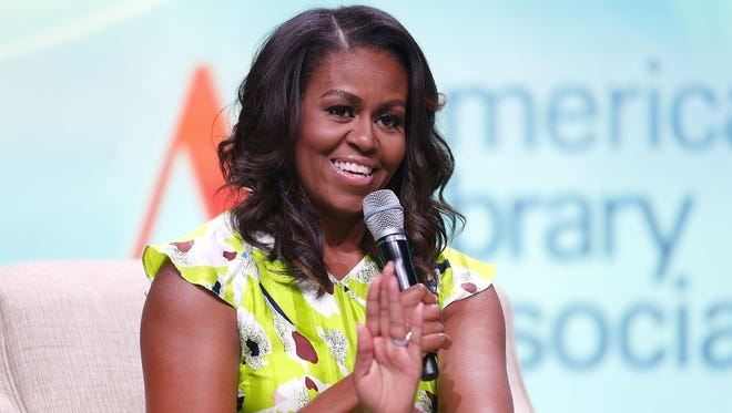 """As part of a limited nationwide run to promote her new memoir, """"Becoming,"""" Michelle Obama will appear in-person at Little Caesars Arena Dec. 11. (Getty Images)"""