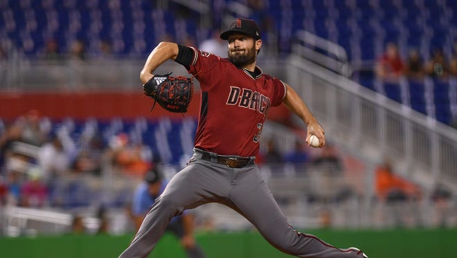 Robbie Ray #38 of the Arizona Diamondbacks pitches in the first inning during the game against the Miami Marlins at Marlins Park on June 27, 2018 in Miami, Florida.
