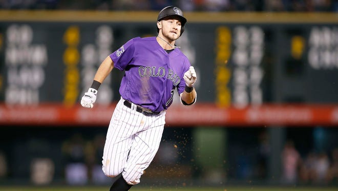 Rockies infielder Garrett Hampson hustles to third base for a triple during a game against the Astros earlier this week.