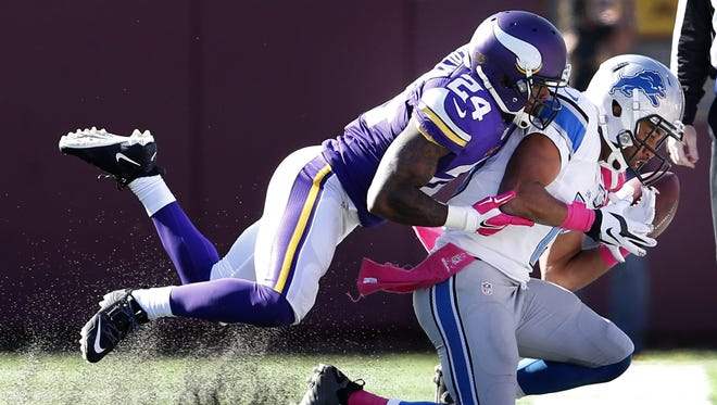 Minnesota Vikings' Captain Munnerlyn (24) breaks up a pass intended for Detroit Lions wide receiver Golden Tate (15) during the fourth quarter on Sunday, Oct. 12, 2014, at TCF Bank Stadium in Minneapolis.