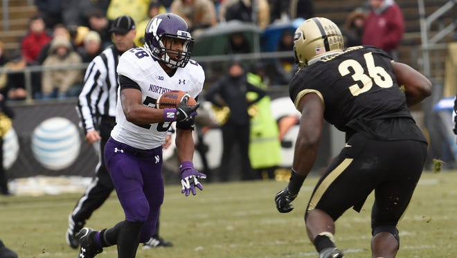 Northwestern Wildcats running back Justin Jackson (28) looks to run as Purdue Boilermakers linebacker Danny Ezechukwu (36) awaits in the first half at Ross Ade Stadium.