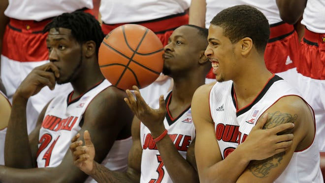 Montrezl Harrell, left, Chris Jones, and Wayne Blackshear sit before the team picture was made at the KFC Yum! Center.October 19, 2014