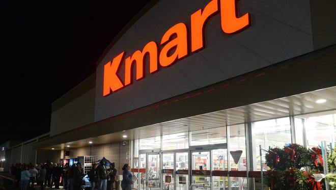 Hundreds bundle against the cold Thanksgiving morning outside the Kmart in Salisbury to catch the earliest Black Friday sales.