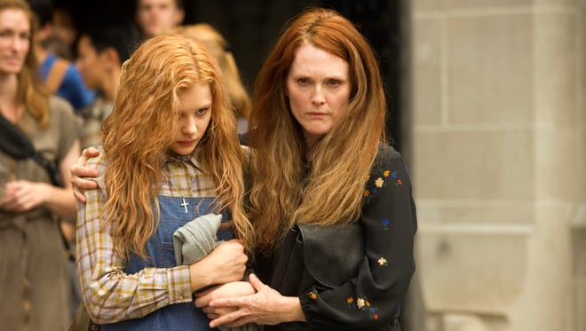 Chloe Moretz, left, and Julianne Moore star in the remake of the Stephen King classic 'Carrie.'