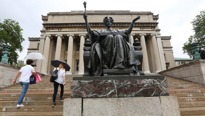People climb the stairs to the Columbia University library July 1, 2013, in New York City.